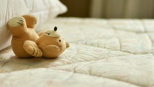 teddy bear on mattress