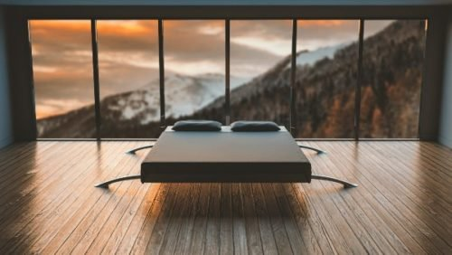 bed with a mountain background