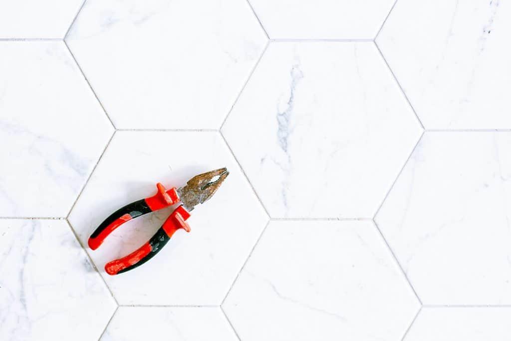 red wire cutter on ceramic floor